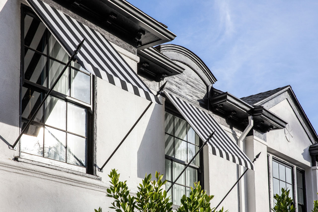 hotel exterior striped awnings